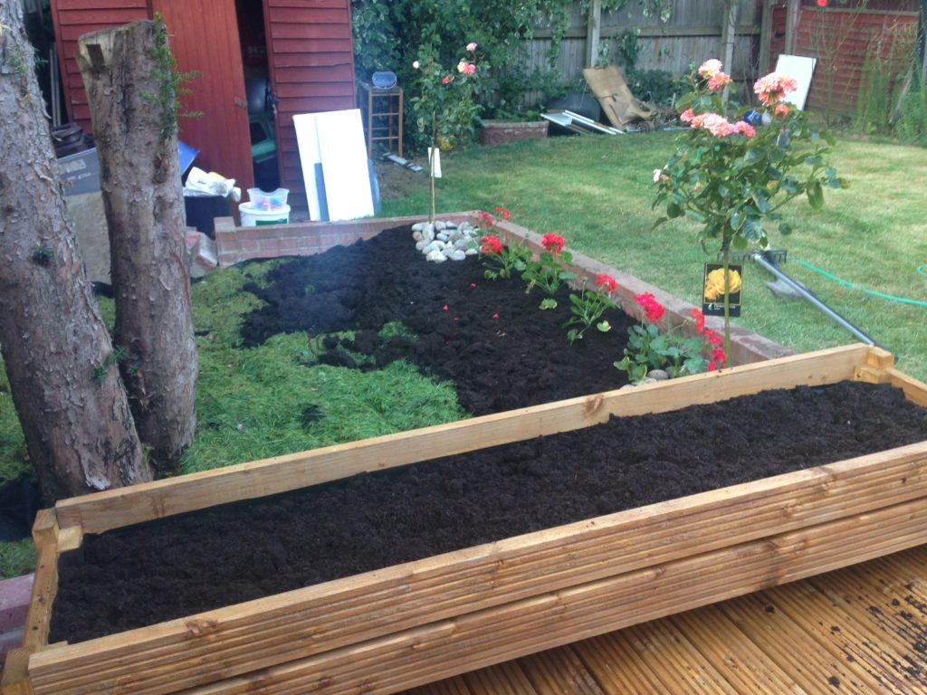 Building flower pot with decking boards